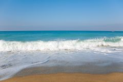 Sky, sea, waves and sandy beach. Stock Photos