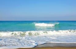Sky, sea, waves and sandy beach. Stock Image