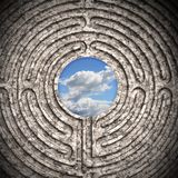 The sky seen through a labyrinth carved in stone. Business concept toned image Royalty Free Stock Photo