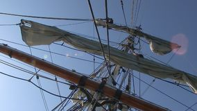 Sky with a ship`s sail stock video