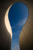 Sky shown through a curvy concrete structure . Royalty Free Stock Photo
