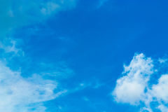 The sky is a small cloud floating in the sky. Stock Photography