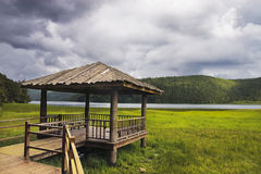 Sky and Small log cabin Stock Photography