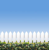 Sky and small white fences. Small white fences shot against clear blue sky stock images