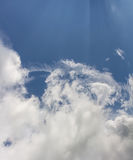 Sky. Smoke clouds and sun light in blue sky Stock Images