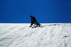 Sky, snow and mountain biker Royalty Free Stock Photos