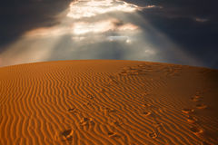 Sky split over the desert sand Royalty Free Stock Image