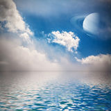 Sky with stars and planet reflected in water. Royalty Free Stock Photography