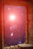 Constellations supernova ancient window. The sky with stars and some supernova star visible through an old ancient stone window Royalty Free Stock Photo