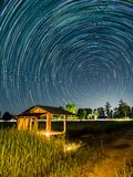Star trail at the field. Sky and stars royalty free stock photo