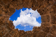 Sky in stone hole. Window in stone wall - archaeology background Stock Images