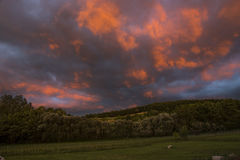 Sky before storm. Incredible sky before the thunderstorm. Red clouds over the hills royalty free stock photography
