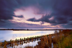 Sky at storm in morning. Sky during morning storm over lake at long exposure Royalty Free Stock Image