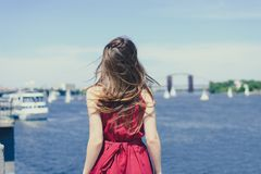 Sky sun blue water nature joy escape emotion expressing resort hairdress world cruise concept. Rear back behind view portrait phot. O of pretty happy excited stock images