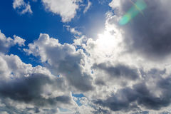 Sky with sun and clouds. Stock Photos