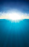 Sky Sun Sea. Sunbeams going trough the clouds and the water Royalty Free Stock Photo