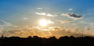 Sky. Sun shine in blue and orange sky with backlit tree Royalty Free Stock Photos