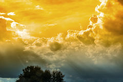 Sky with the sun shines through the rain clouds Background. Stock Images