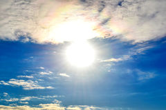 Sky with sun,solar halo and clouds Royalty Free Stock Photography