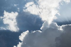 Sky and Sunray. Sun rays breaking through the clouds stock photo