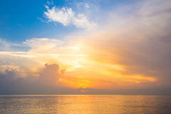 Sky, sunrise and waves at the beach Royalty Free Stock Images