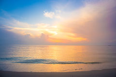 Sky, sunrise and waves at the beach Stock Image