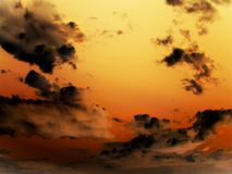Sky at sunset. Beautiful clouds on orange horizon. Cloudscape Stock Photo