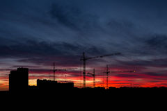 Sky at sunset with cityscape panorama. Sky and crans at sunset with cityscape panorama Stock Photo