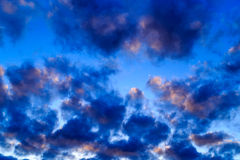 The sky at sunset, the clouds lit only from above. The sky at sunset, the colorful clouds Stock Photos