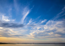 Sky at sunset with clouds and water Royalty Free Stock Photos