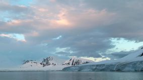 The sky is at sunset and the coast of Antarctica. Andreev. stock video