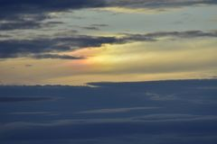 The Sky At Sunset. At dask the sun rays beautify the clouds Stock Photos