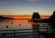 Sky. Sunset. Dock. Color. Lake. Vevey. Silhouette stock photography