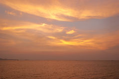 Sky at sunset with ocean as background Stock Photography