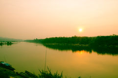 Sky at sunset over Mekong river, fisherman boat Royalty Free Stock Image