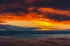 Sky during sunset view over the colored clouds. Sky during sunset view over the colored clouds Royalty Free Stock Images