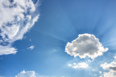 Sky. Sunshine behind colorful white clouds in free space blue sky Stock Photo