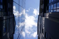 Sky between tall buildings royalty free stock photo