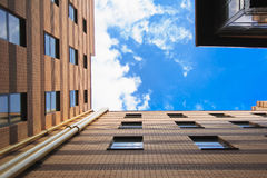 Sky between tall buildings Stock Images
