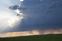 The sky before a thunder-storm. The dark blue sky before a thunder-storm, sun beams shine the sky Stock Photography