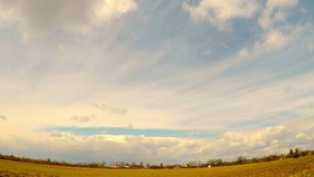 Sky timelapse white clouds over the village stock video footage