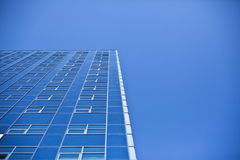 Sky-tower. Blue skyscraper on blue sky as bacground Royalty Free Stock Images