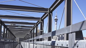 Sky Tower from Gantry structure in Wynyard Quarter Auckland New Zealand stock video