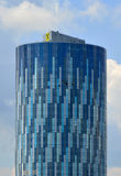 Sky tower office business building in Bucharest city. With four men washing windows Royalty Free Stock Images