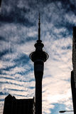 Sky Tower. The silhouette of the SkyTower against a cloudy sky on the background. nThe Sky Tower is a landmark of the city of Auckland, in New Zealand Stock Photography