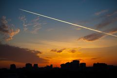 Sky and the trace of the aircraft. Over Moscow City on morning royalty free stock image