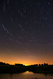 Sky trail in the night sky with bright meteors and aircraft Stock Images