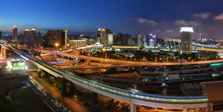 Sky train approaching the station. At Xujiahui area during the dusk period Stock Images