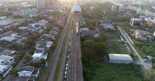 Sky Train departing from train station in Bangkok. An aerial view of sky Train departing from train station in Bangkok stock video footage