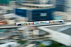 Sky Train in motion between station NANA and ASHOKA in Bangkok Stock Photos